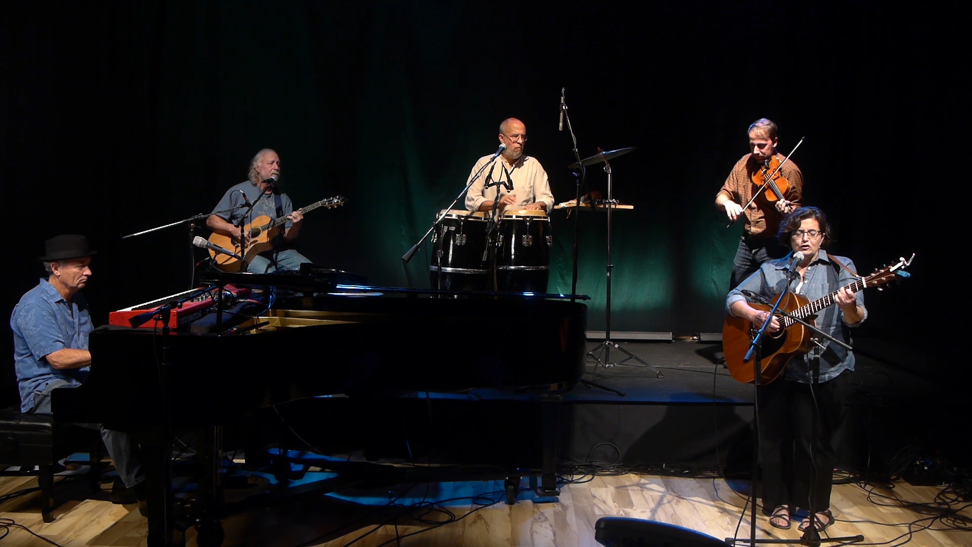The Pam Ortiz Band with Philip Dutton on piano, Ford Schumann on guitar, Bob Ortiz on percussion, Nevin Dawson on viola and Pam Ortiz on guitar.
