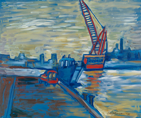 """Tug boat is attached to dock; """"Rudolf"""" crane in the distance with buildings in background; car sitting on dock."""