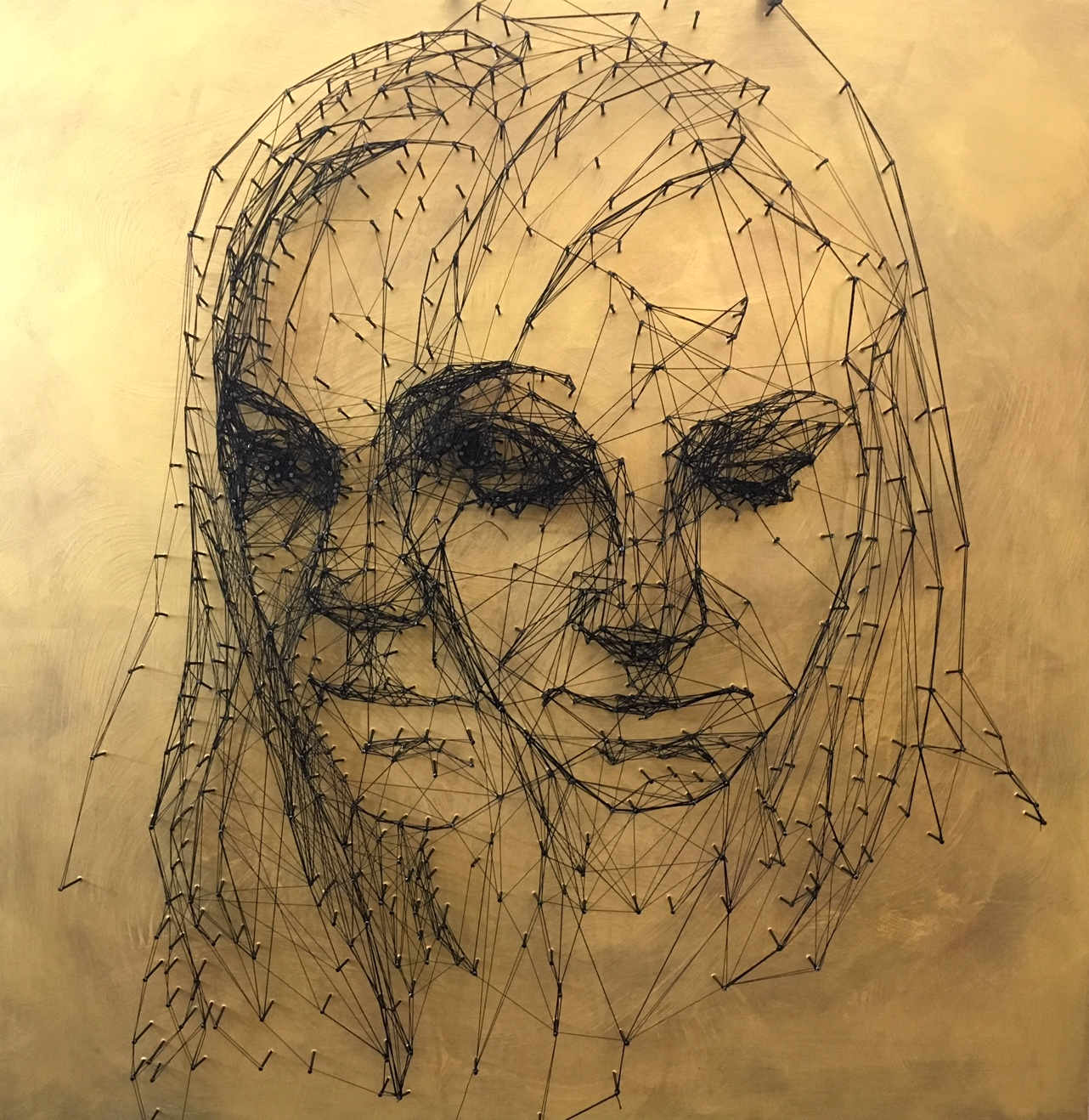 Nail and thread drawing on the wood board