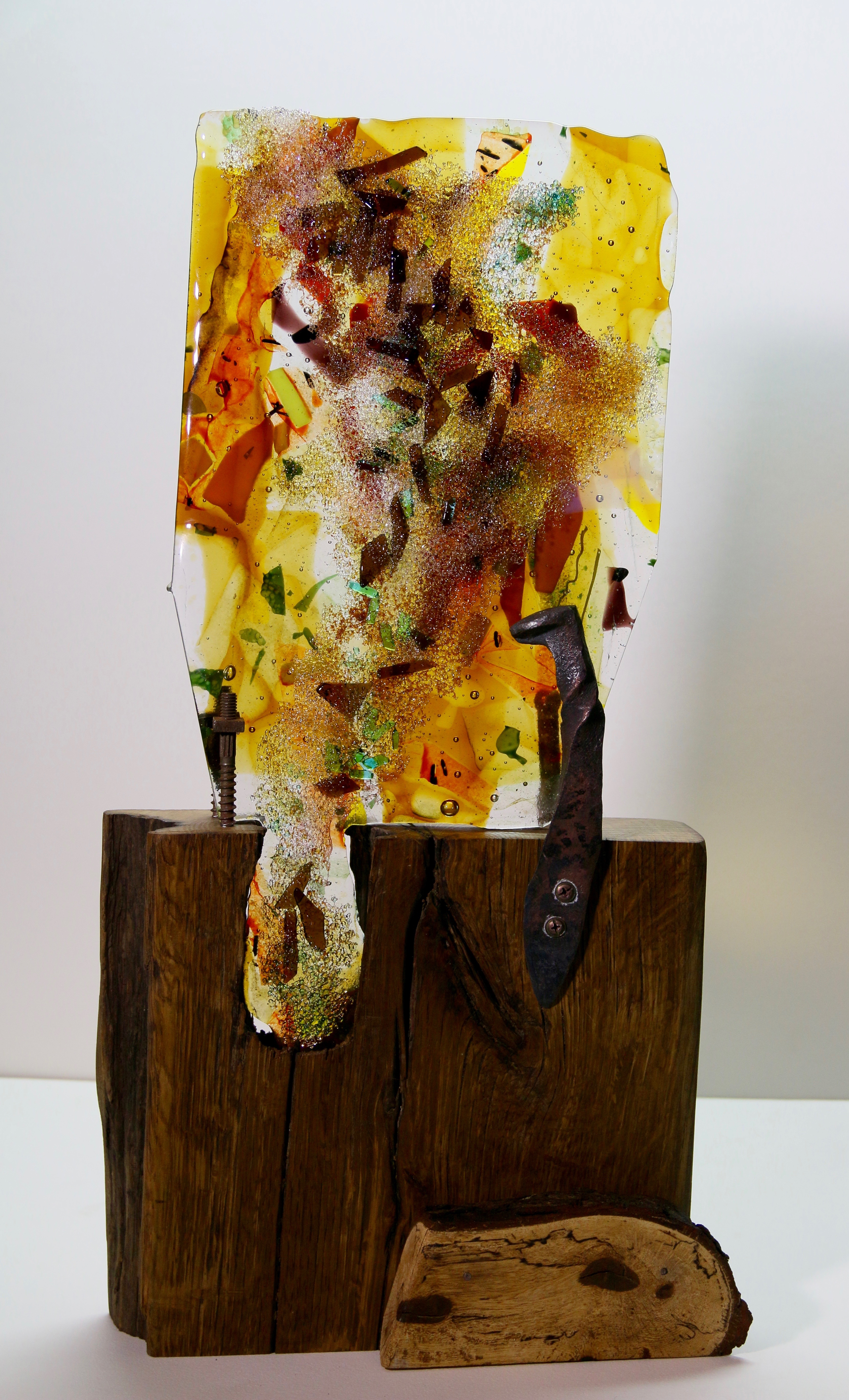 Fused glass sculpture with wood base and fired steel holders