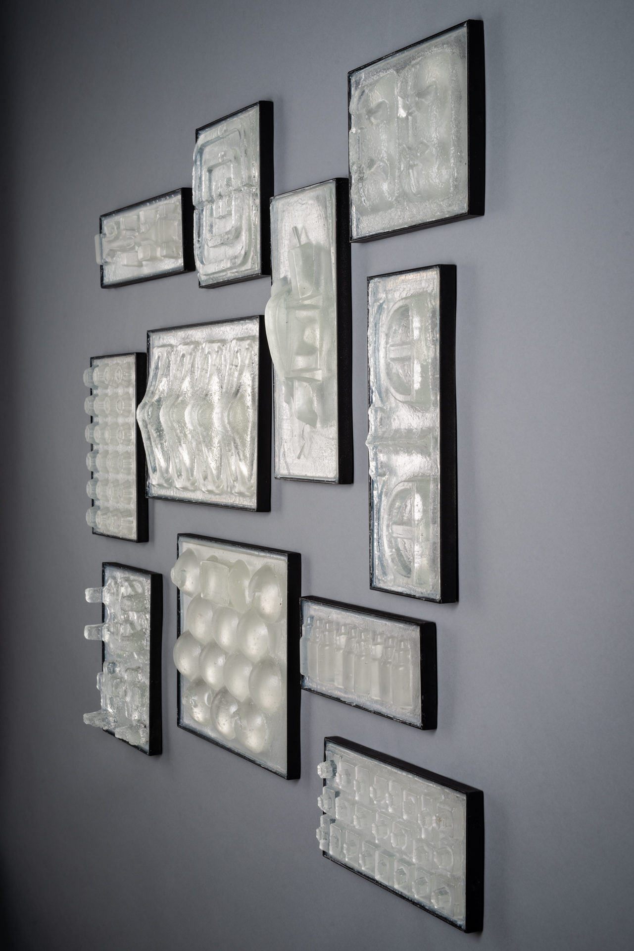 Wall sculpture from recycled glass, steel