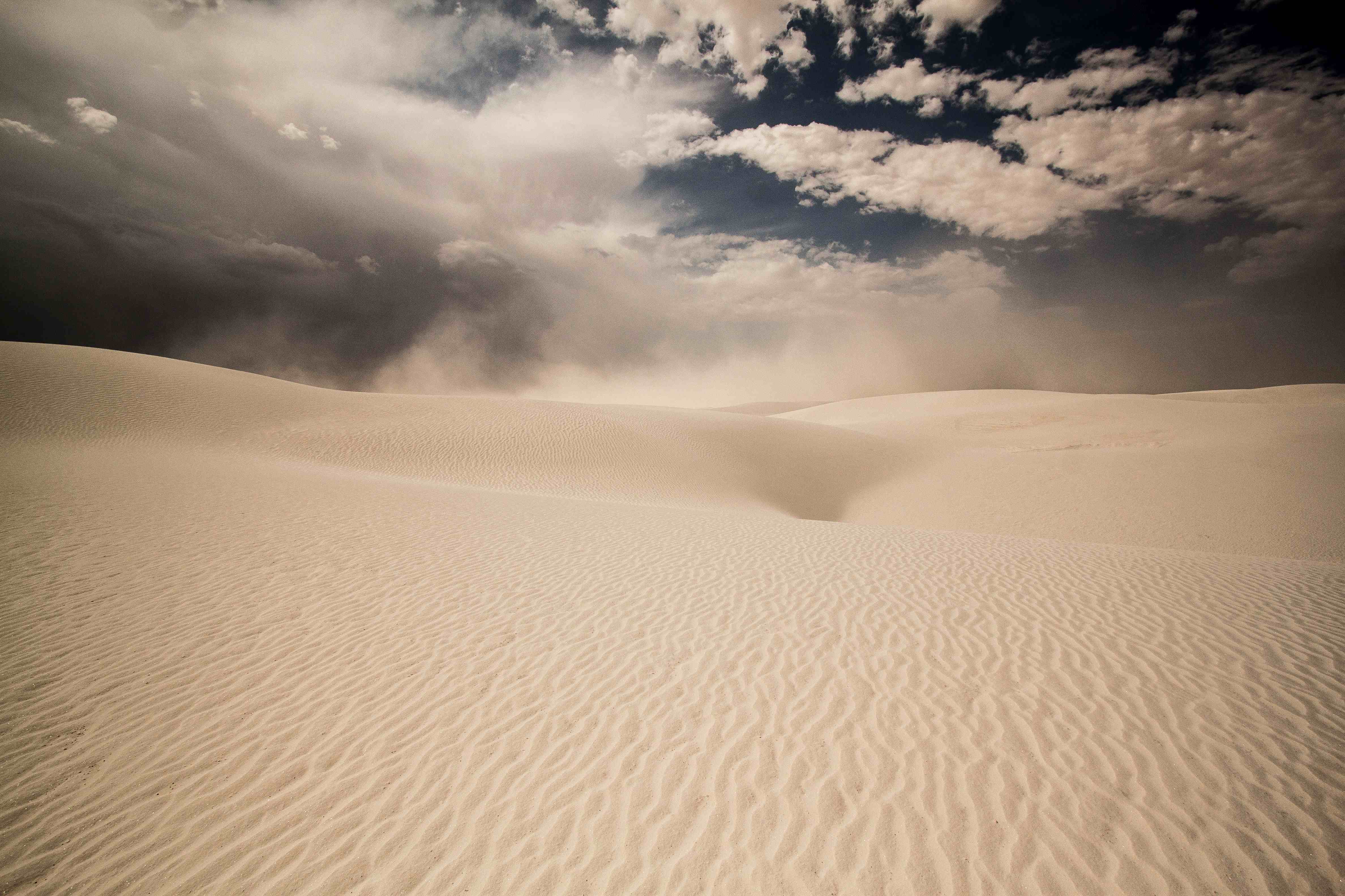 A sandstorm crests the dunes in White Sand National Monument, New Mexico