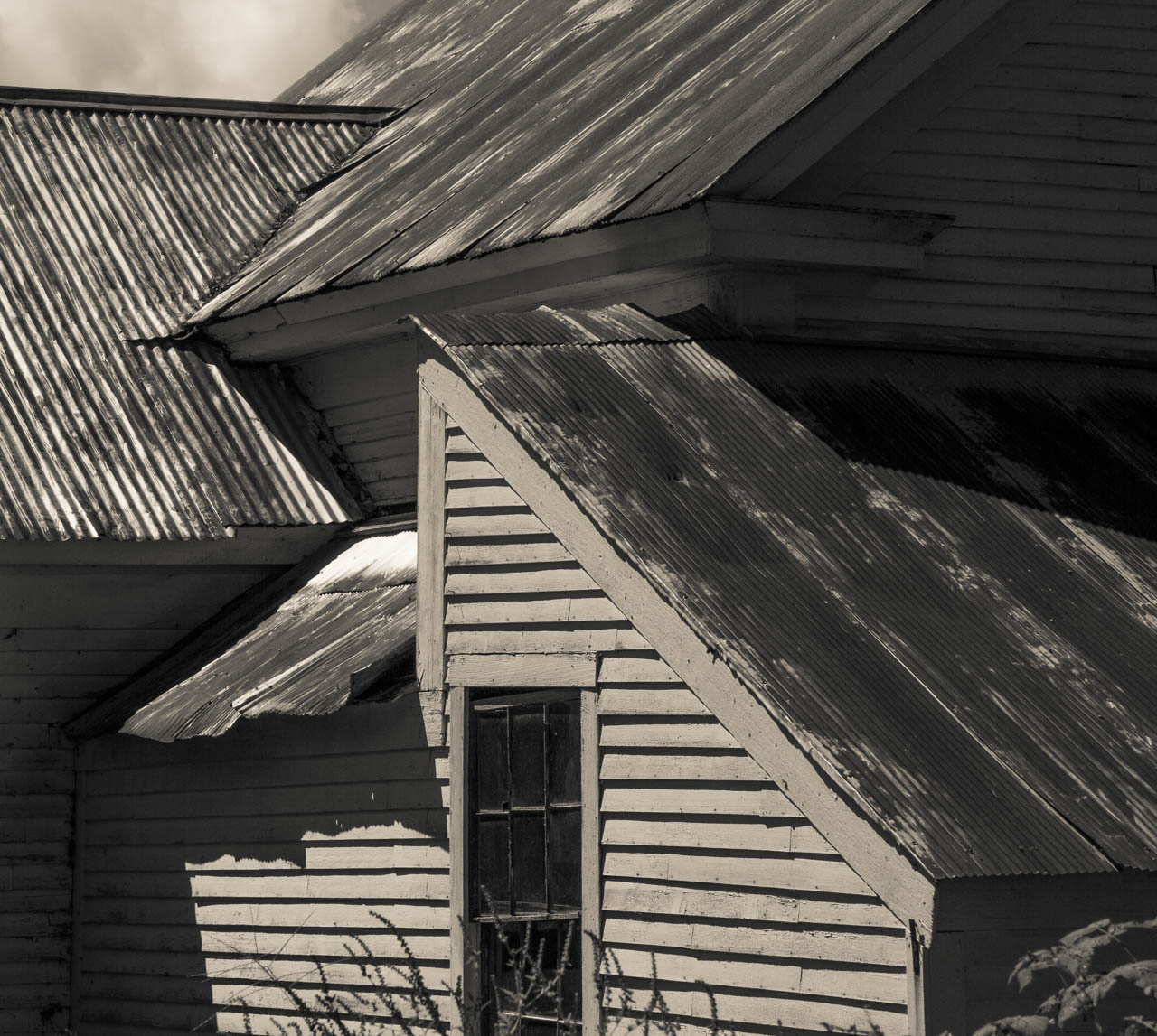 New England farmhouse.  Shadows and lines.