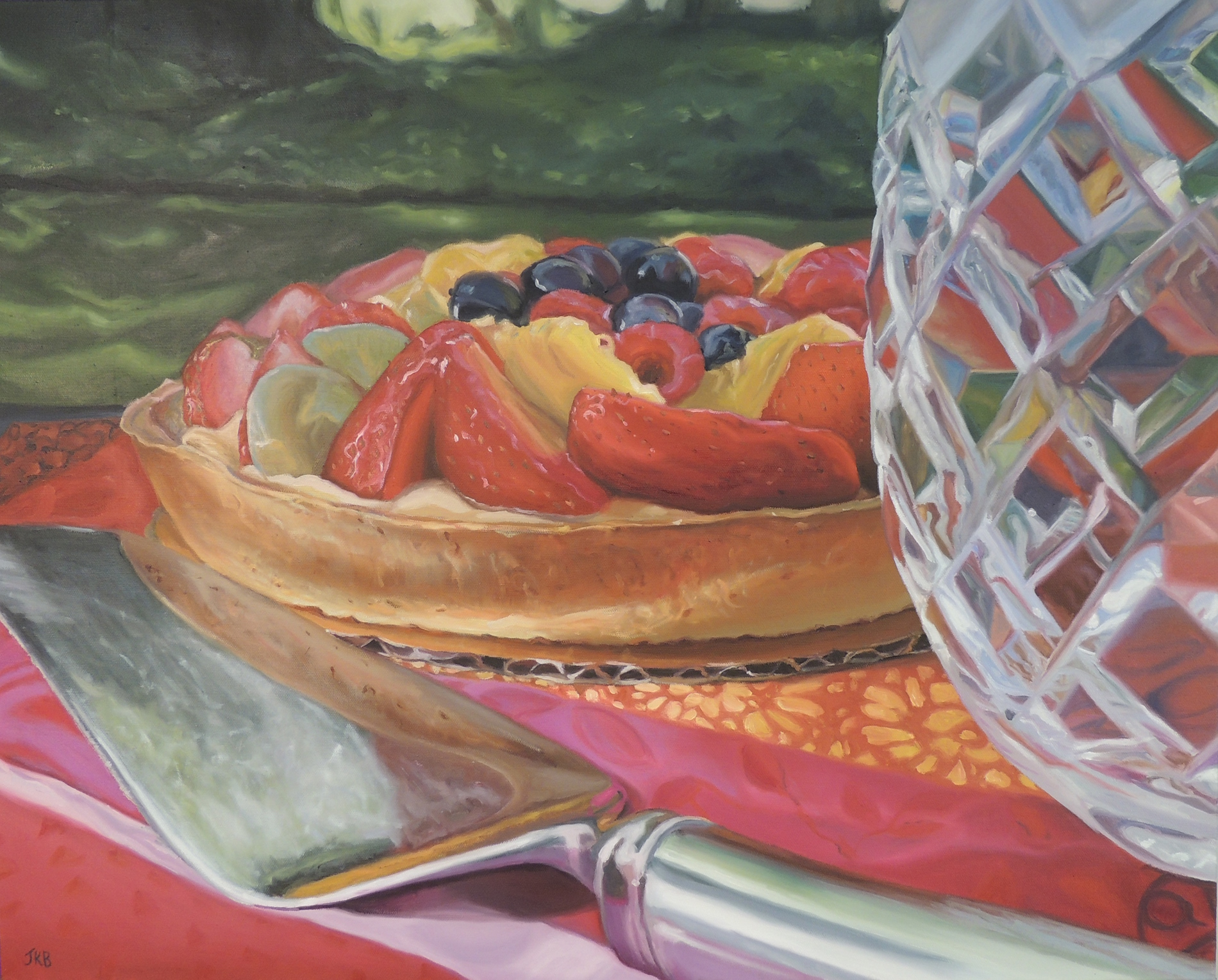 Vibrant, colorful fruit tart awaiting consumption.